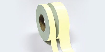 Photoluminescent polyester tape self-adhesive backing