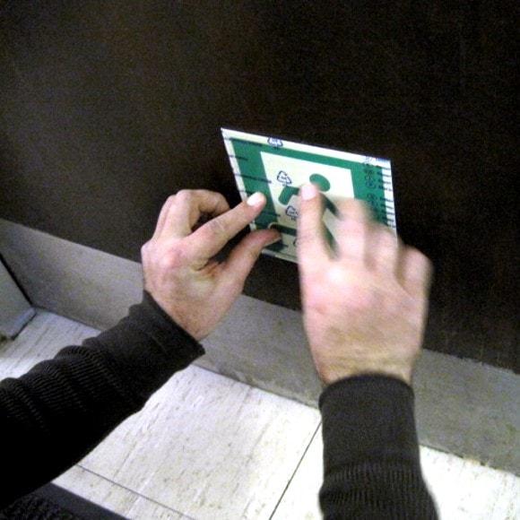 Certified Installer applies Emergency Exit Symbol