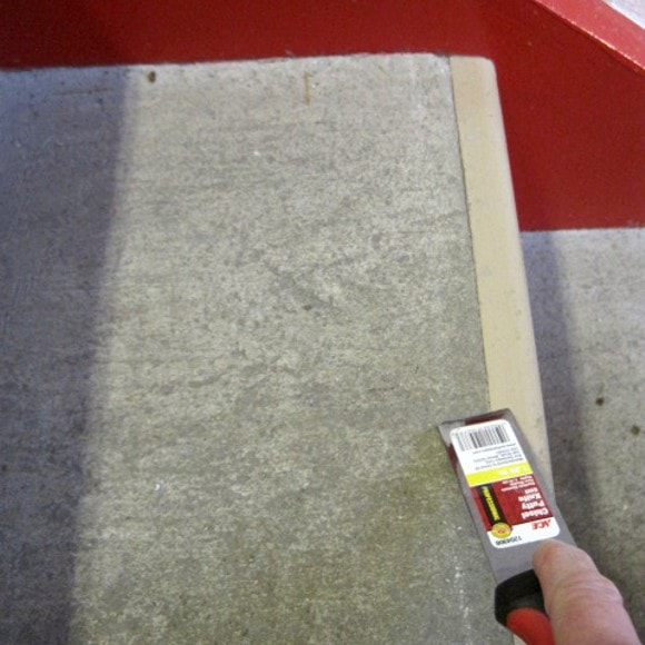 Certified Installer prepares the step surface