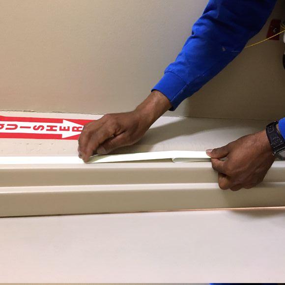 Certified Installer marks Exit Door frame tape