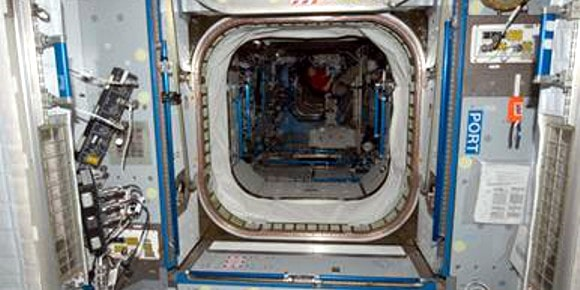 Node 2 into Lab Module on ISS with pl circular markers around hatch